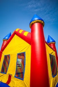 Boy Injured When Bouncy Castle Blows onto Highway